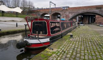 Photograph of a narrowboat moored at Castlefield in Manchester.