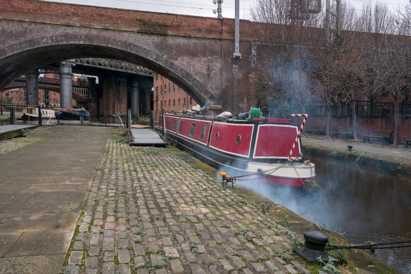 Canal boats moored in Castlefield Manchester. Location is adjacent to the Castlefield Bowl.