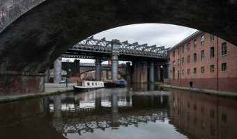 Railway viaducts over the Castlefield Basin in Castlefield, Manchester. The building on the right is the YHA Manchester (youth hostel) at Potato Wharf.