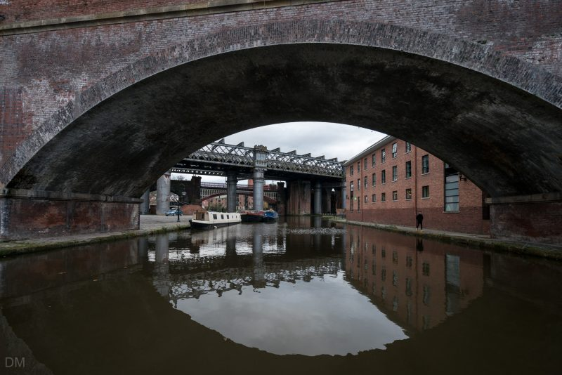 Photo of the Castlefield Basin in Manchester; the junction of the Bridgewater Canal and Rochdale Canal. Building to the right is the YHA Manchester at Potato Wharf.