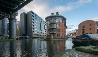 Photograph of Potato Wharf in Castlefield, Manchester. Buildings to the left are the Potato Wharf apartments. Building on the right is the YHA Manchester.