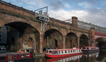 Photo of narrowboats on the Bridgewater Canal in Castlefield, Manchester.