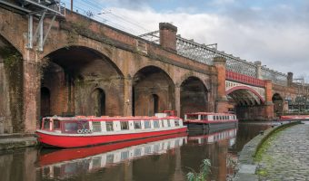 Photo of the Bridgewater Canal, just before it meets the Rochdale Canal at the Castlefield Basin in Castlefield, Manchester.