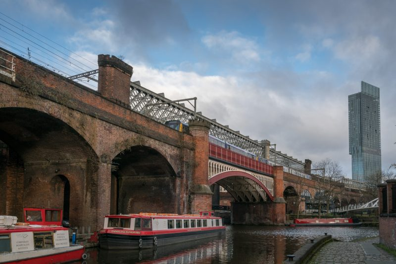 Photograph of the Castlefield Basin, the junction of the Rochdale Canal and Bridgewater Canal in Manchester city centre. Beetham Tower in the background.