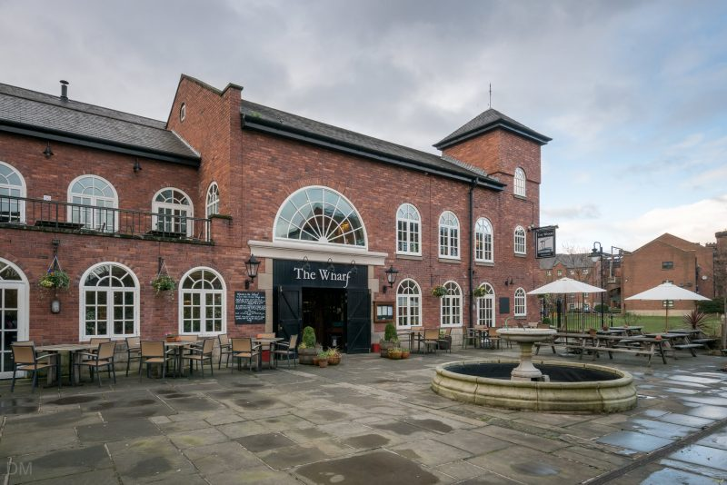 Photo of The Wharf, a pub adjacent to the Bridgewater Canal in the Castlefield of Manchester.