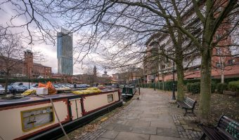 Narrowboats on the Bridgewater Canal in Castlefield, Manchester. The Beetham Tower can be seen in the background.
