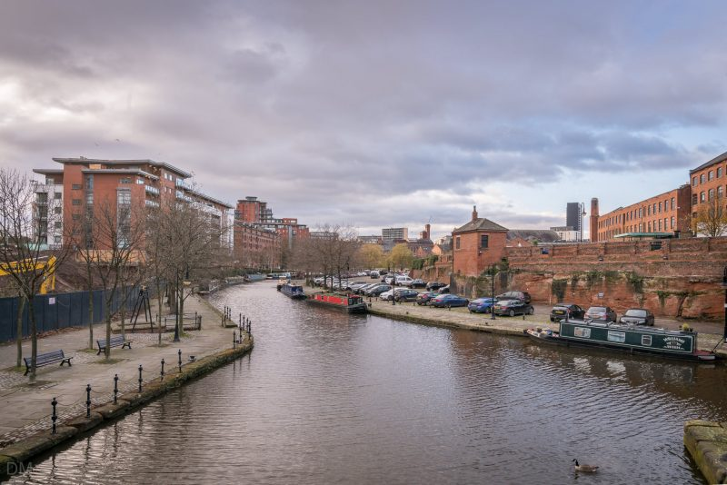 View of the Bridgewater Canal in Castlefield, Manchester city centre. Castlegate apartments are on the left of the photograph.