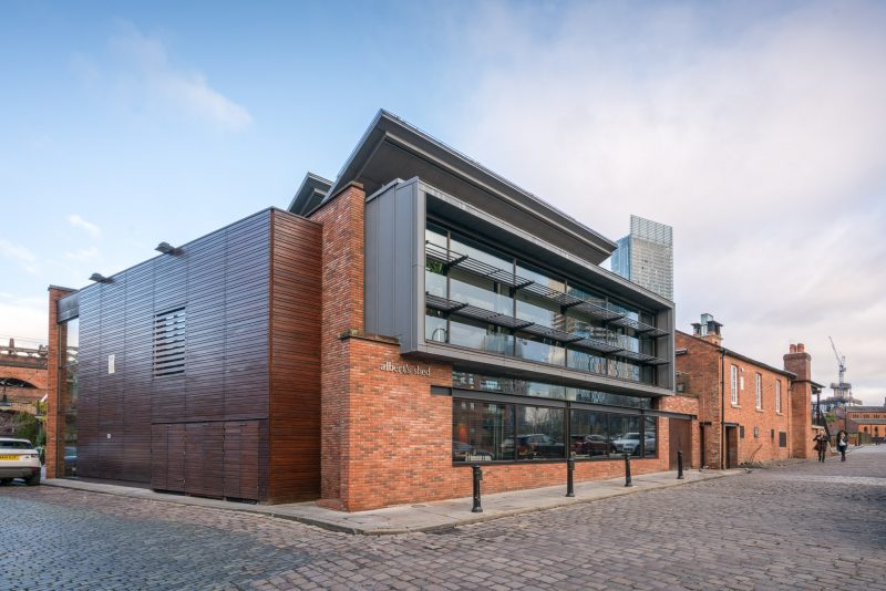 Photo of the Albert's Shed restaurant on Castle Street in Castlefield, Manchester. Beetham Tower in the background.