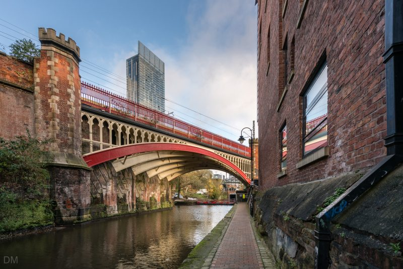 View of the Beetham Tower and a railway bridge over the Rochdale Canal.