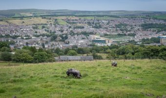 Photo of Darwen in Lancashire. Taken from Darwen Moor. Darwen Leisure Centre can be seen at the centre of the image.