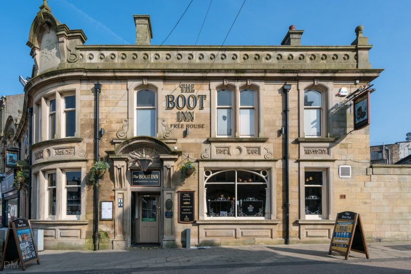 Photograph of The Boot Inn, a Wetherspoon pub on St James' Street in Burnley town centre. It is a Grade II listed building and opened in 1911.