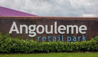 Photograph of sign on the wall of Angouleme Retail Park in Bury.