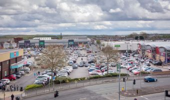 Photograph of Angouleme Retail Park, Bury. Halls Mill Retail Park is in the distance.