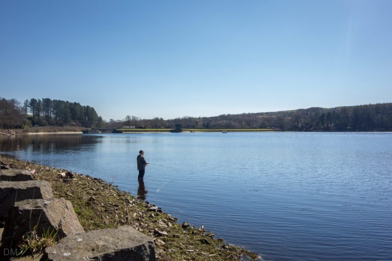 Photo of a man fishing at Turton and Entwistle Reservoir in Edgworth, Lancashire.