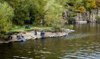 Photo of two men fishing at Jumbles Reservoir, Jumbles Country Park, Bolton.