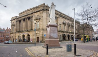 Photograph of King George's Hall and the statue of William Ewart Gladstone (Prime Minister) in Blackburn town centre.