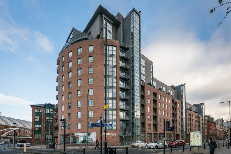 Photograph of the Hacienda Apartments on Whitworth Street West in Manchester. The former warehouse was previously occupied by Factory Record's Hacienda nightclub.