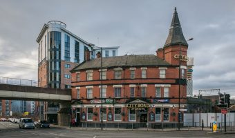 Photograph of the City Road Inn, a pub at the corner of Albion Street and Whitworth Street West in Manchester city centre.