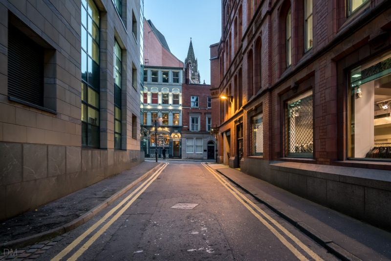 Photograph of Essex Street in Manchester city centre. The small street links King Street to Tib Lane.
