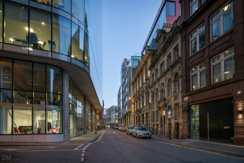 Photograph of Booth Street in Manchester city centre. The King Street Townhouse hotel can be seen on the right. Chancery Place, the large glass office building, is on the left.
