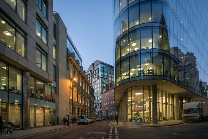 Photo of Chancery Place in Manchester. The glass-walled office building is situated on Booth Street, opposite the King Street Townhouse hotel.