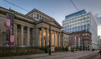 Photograph of Manchester Art Gallery on Mosley Street. Two St Peter's Square, an office building on St Peter's Square, overlooks.