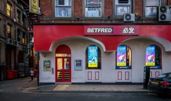 Photograph of the Betfred betting shop on Nicholas Street in Chinatown, Manchester.
