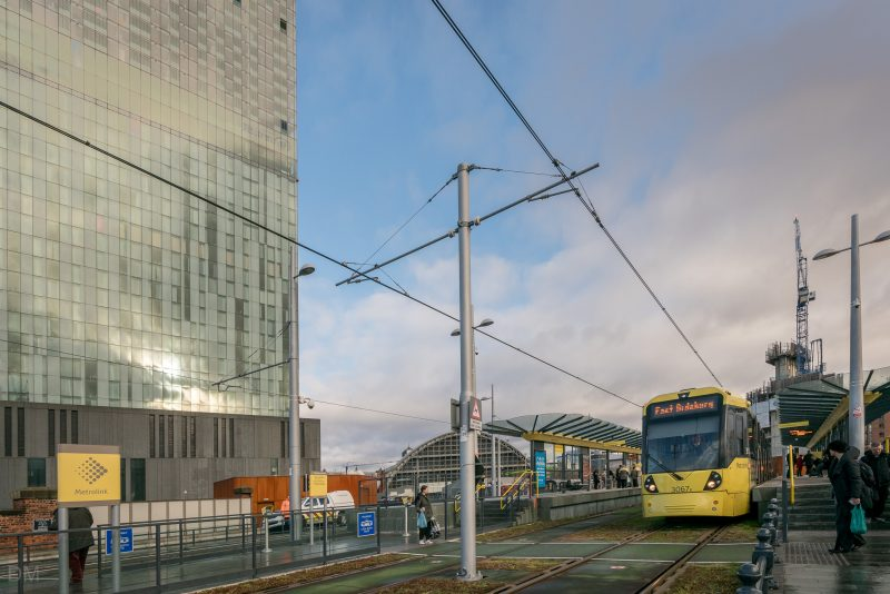 Photo of Deansgate-Castlefield Tram Stop (Metrolink). The large building on the left is the Beetham Tower.