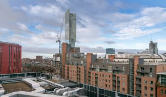 Photograph of the Hacienda Apartments and Beetham Tower in Manchester. The roof of Manchester Central and the Great Northern Tower can also be seen.