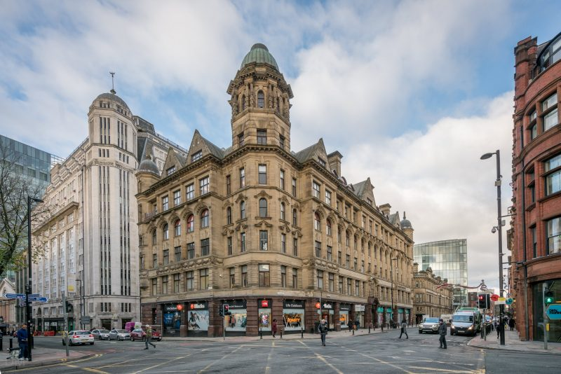 Photo of the Blacks outdoor clothing and equipment store on Deansgate in Manchester. The shop is situated on the ground floor of Royal London House, a listed building at the corner of Deansgate and Quay Street.