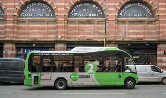 Photo of a Metroshuttle bus on Deansgate in Manchester, near the Great Northern.