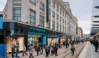 Photograph of Primark on Market Street in Manchester city centre. The Market Street Tram Stop (Metrolink) is on the right.