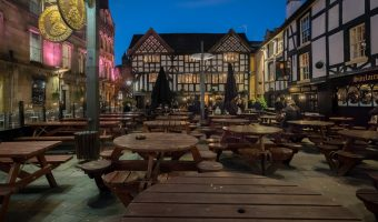 Photograph of Shambles Square in Manchester city centre at night.
