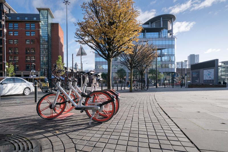 Photograph of Mobikes parked outside Manchester Central.