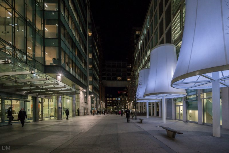 Photo of Hardman Boulevard at Spinningfields at night. The XYZ Building is on the right of the photo. 1 Hardman Boulevard is on the left. Both are office buildings.
