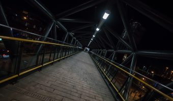 Photo of the footbridge over Whitworth Street West, linking Deansgate-Castlefield Tram stop to Deansgate Train Station.