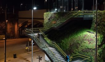 Photo of stairs to the Deansgate-Castlefield Tram Stop. The design, by SimsonHaugh architects, features a living wall.