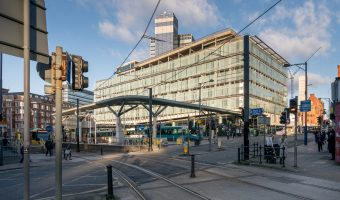 Photograph of Shudehill Interchange, a transport hub in Manchester city centre. It comprises Shudehill Tram Stop (Metrolink) and Shudehill Bus Station.