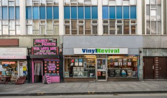 Photo of Vinyl Revival, a music shop in Manchester's Northern Quarter. It specialises in records from Manchester bands and also stocks music posters and memorabilia.
