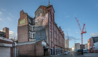 Photo of mural on the wall of the Swan Buildings in Ancoats, Manchester. The work is by German artist Case.