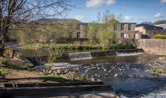 Photo of a weir on the River Irwell in Ramsbottom. Taken from Bridge Street Gardens, a small park near Ramsbottom Train Station.