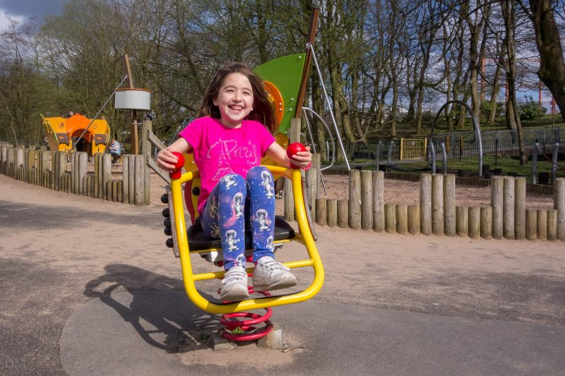 Photograph of a girl on the playground at Queens Park, Bolton.