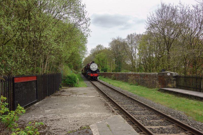 Photograph of an East Lancashire Railway train approaching Summerseat Train Station.