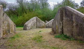 Photograph of Stone Cycle, a sculpture by Julie Edwards. It is situated at Burrs Country Park in Bury and is part of the Irwell Sculpture Trail.