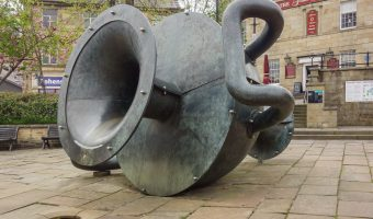 Photograph of Edward Allington's Tilted Vase in Ramsbottom. The sculpture of a giant vase lies on Market Place in Ramsbottom town centre. It is part of the Irwell Sculpture Trail.