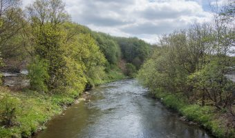 Photograph of the River Irwell. Viewed from Peel Brow in Ramsbottom.