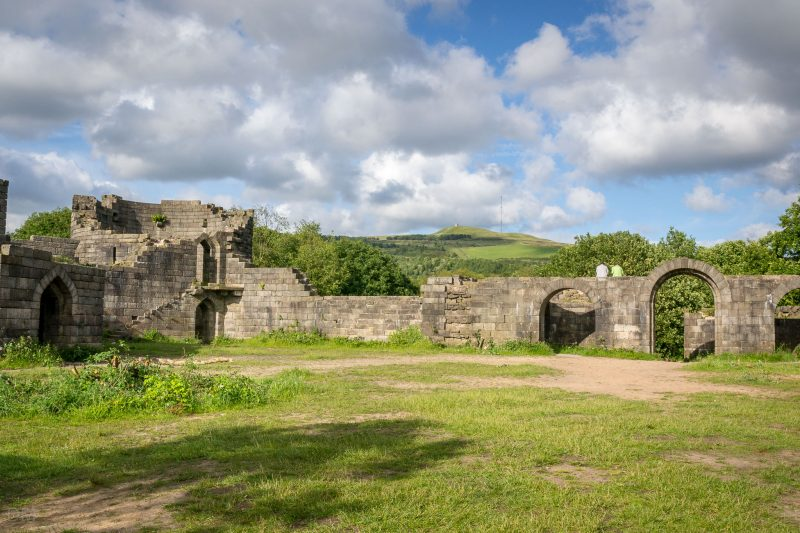 Photograph of Liverpool Castle in Rivington, Lancashire. Winter Hill, Winter Hill Transmitting Station, and Rivington Pike can be seen in the distance.