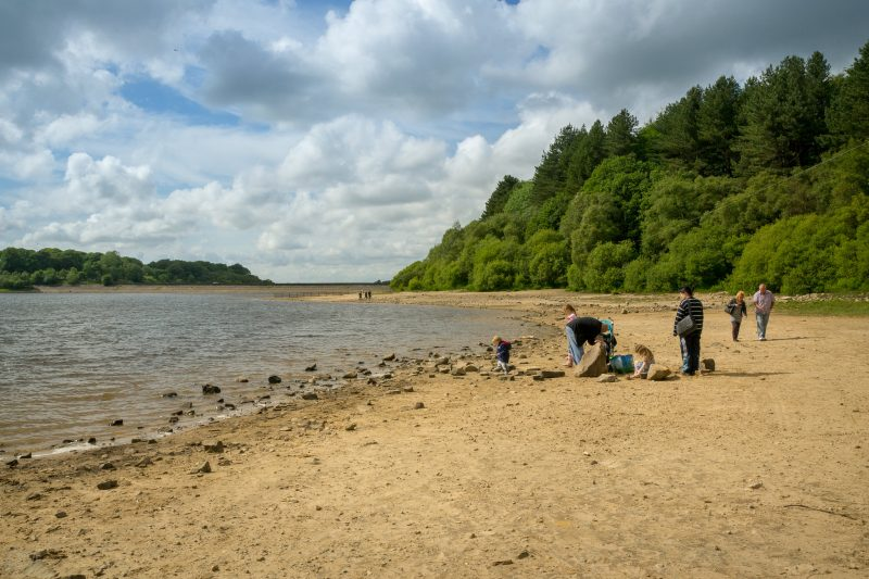 Photograph of family relaxing on the shore of Lower Rivington Reservoir in Chorley, Lancashire.