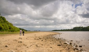 Photo of couple walking along the shore of Lower Rivington Reservoir in Rivington, Chorley.