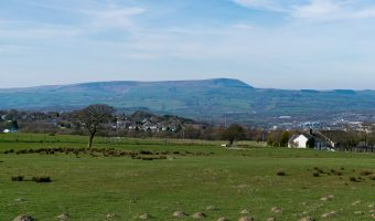 Photograph of Pendle Hill. Viewed from Burnley Golf Club.